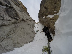 Ian Welsted digging through steep snow and looking for cracks on our first attempt of Pyramid, photo by Kris Irwin